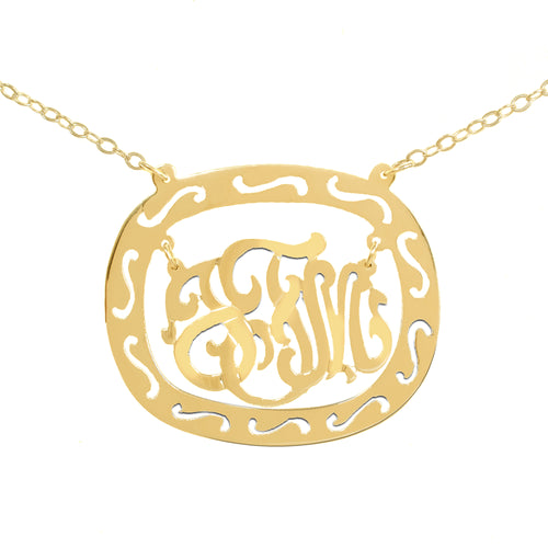 gold-plated silver oval monogram necklace inside thick patterned circular frame