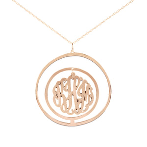 rose gold-plated silver monogram necklace inside double circular pendant