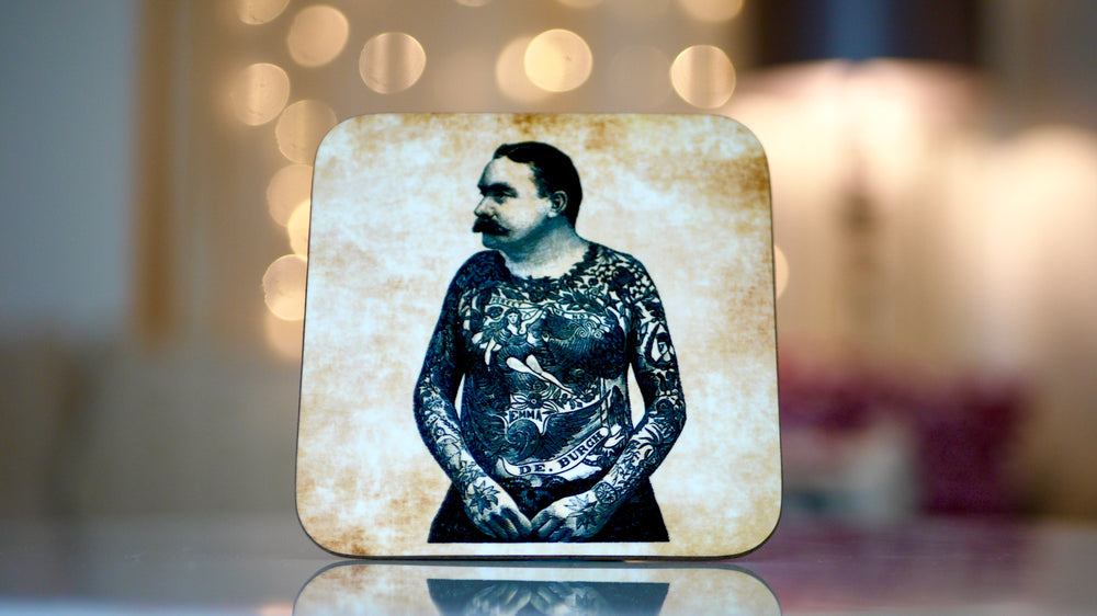 Tattoo Man, hipster coaster.  Is made from wood, and features this circus tattoo man on a beige background.  Can be used as a drinking mat, and has a real antique vintage look to it.