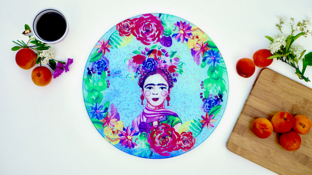 Frida Kahlo chopping board, worktop saver, cutting board.  Makes a real statement in your kitchen with this bright and colourful design.  Made from toughened glass and a perfect gift