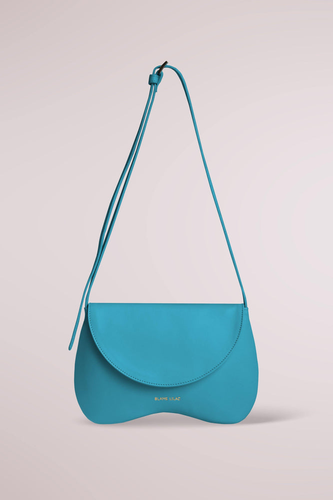 Amorsito Phone Turquoise Shoulder, Crossbody and Collar Bag by Blame Lilac
