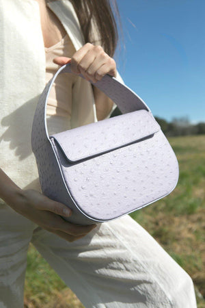 Load image into Gallery viewer, ostrich lilac handbag cesta, ostrich embossed cow leather, removable long strap, Blame Lilac