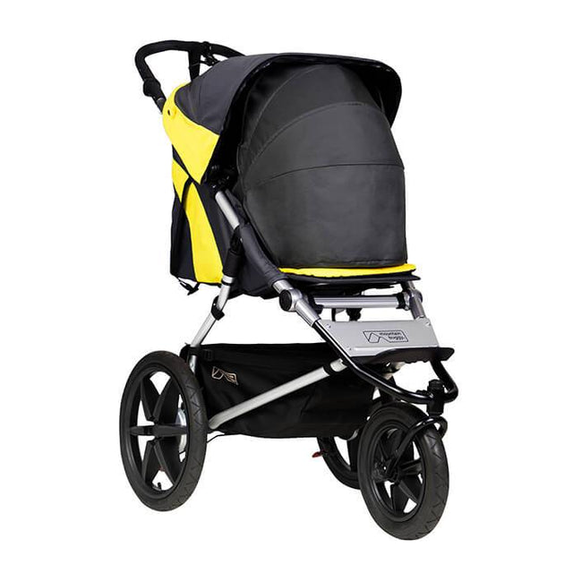 Mountain Buggy terrain stroller in yellow and black solus colour with newborn cocoon accessory_solus