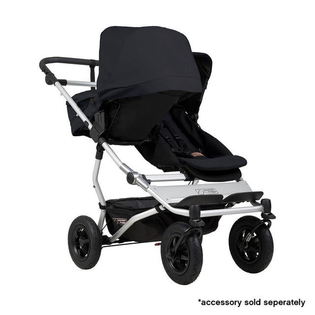 Mountain Buggy duet double buggy fitted with one carrycot plus in parent facing seat position in colour black_black