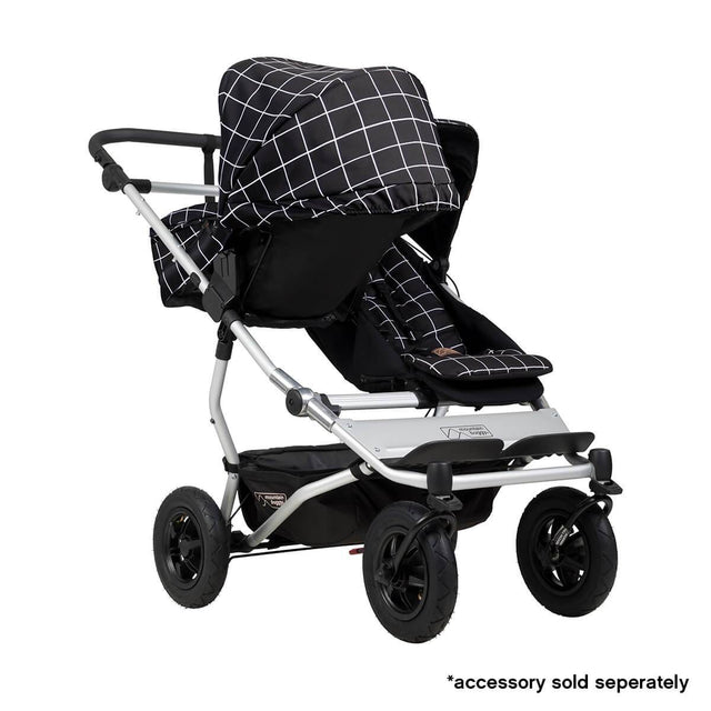 Mountain Buggy duet double buggy fitted with one carrycot plus in parent facing seat position in colour grid_grid