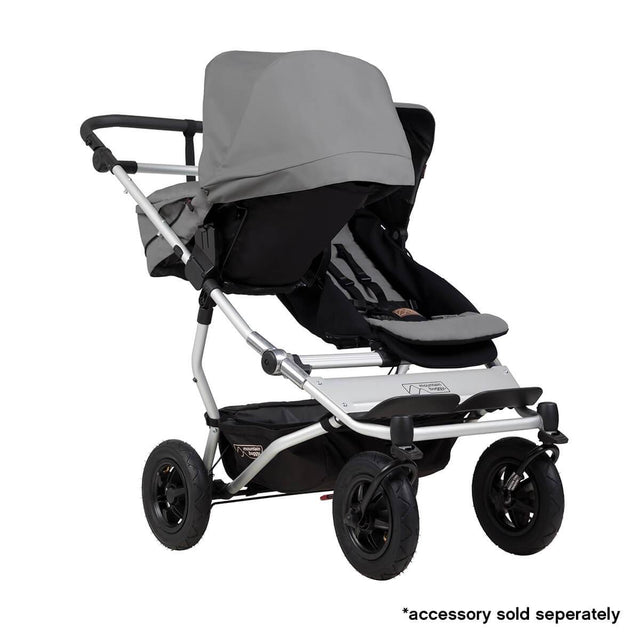 Mountain Buggy duet double buggy fitted with one carrycot plus in parent facing seat position in colour silver_silver