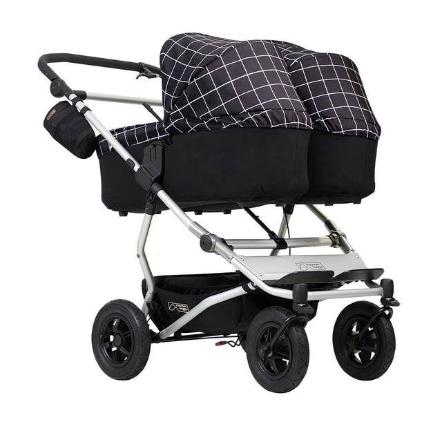 mountain buggy duet double buggy with two carrycot plus in lie flat mode 3/4 view shown in color grid_grid