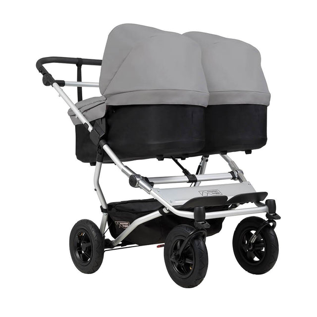 mountain buggy duet double buggy with two carrycot plus in lie flat mode 3/4 view shown in color silver_silver