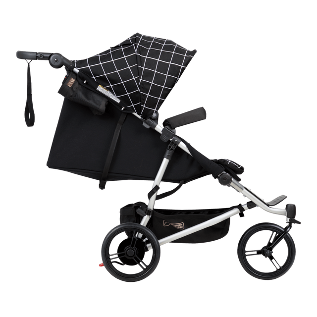 Mountain Buggy duet double buggy side view with main seat in lie flat position in colour grid_grid