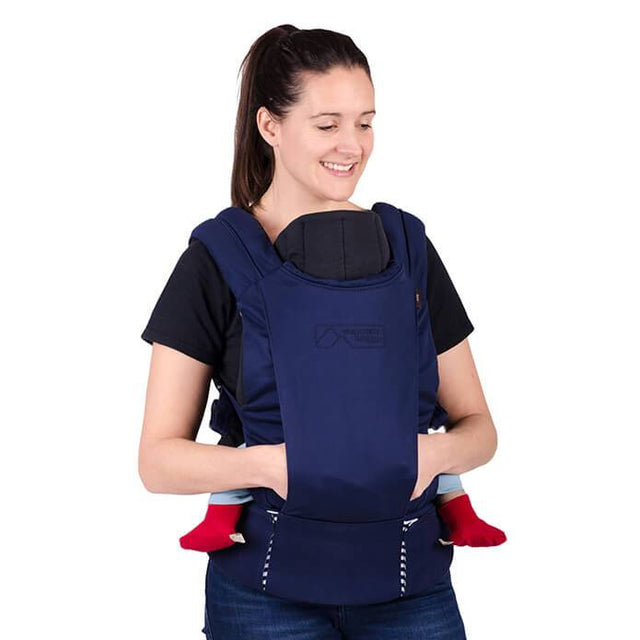 mountain buggy juno baby carrier in nautical blue colour with infant insert in use_nautical