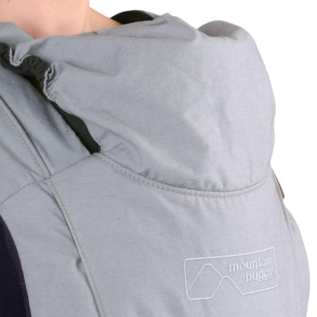 mountain buggy juno baby carrier in charcoal grey colour has a weather protective hood_charcoal