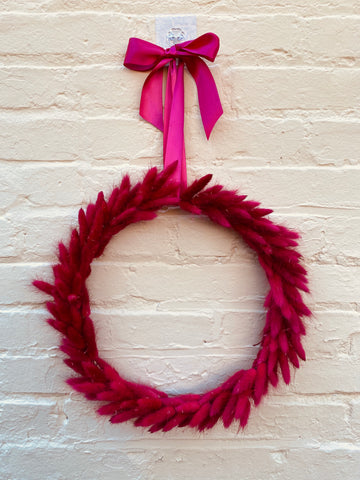 Front view of our monochromatic Cerise Bunny Tail Wreath.  Handmade with pride in America