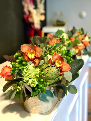 Fall centerpieces lined up on our flower bar