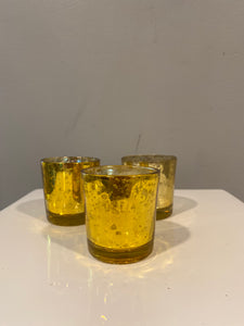 A trio of gold mercury glass votive candle holders. Candles are included with purchase.