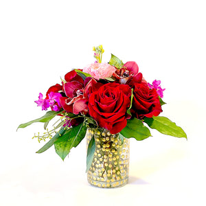 Side View of Premium Mixed Floral Arrangement with roses, ranunculus, orchids, stock, and foliage