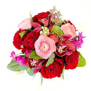 Overhead View of Premium Mixed Floral Arrangement with roses, ranunculus, orchids, stock, and foliage