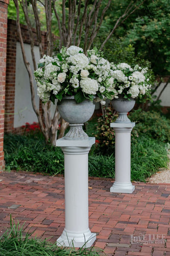 Classic wedding altar arrangements on pedestals for DC wedding