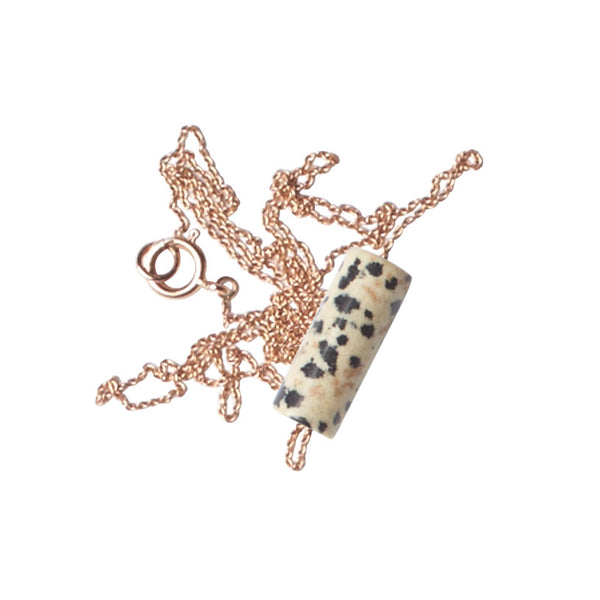 Dalmation Jasper, known to encourage playfulness, is a good stone for the over-analyzing. We've strung a fat tube of it on an extra fine rose gold chain as a talisman for the worrier. \n\nIn so doing, we are working in a long line of other humans similarly preoccupied with stones: