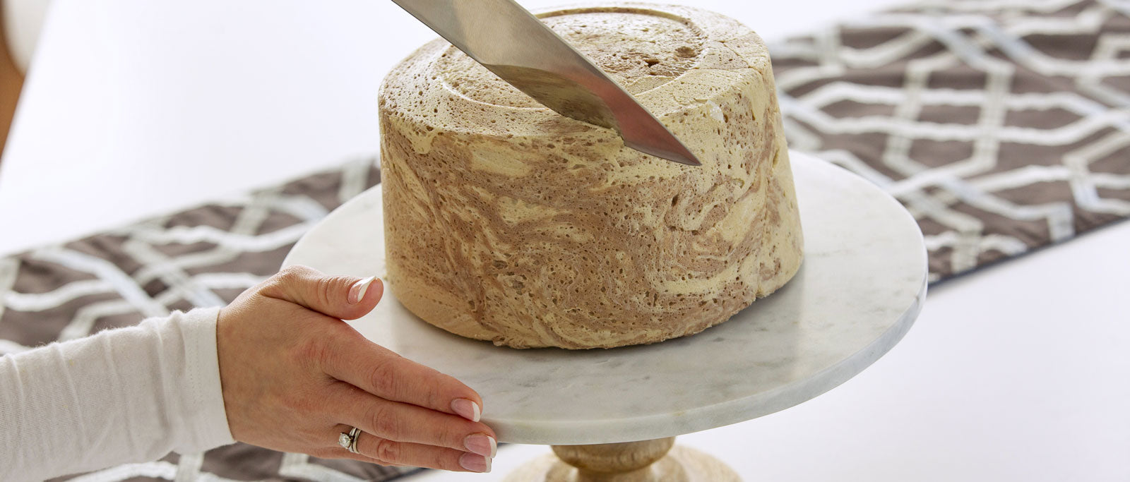 Halva cake being sliced