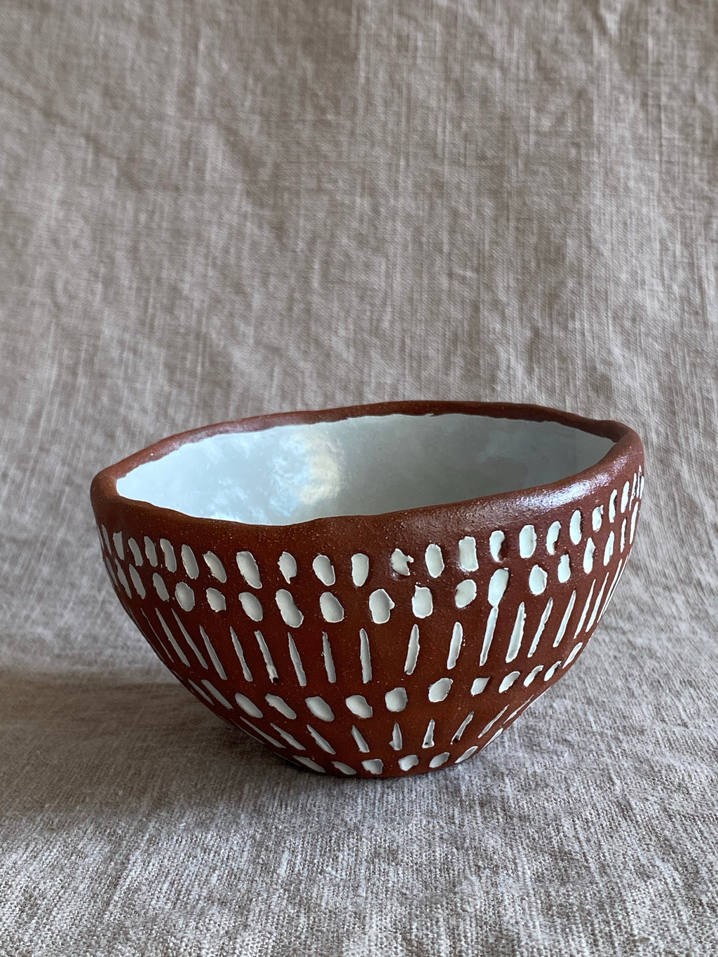 Small Decorative Carved Bowl in Red Stoneware