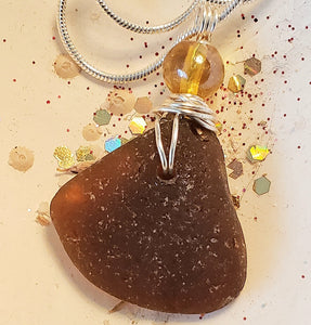 sea glass necklace with amber coloured bead