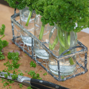 3 glass vase in wire rack with fresh parsley