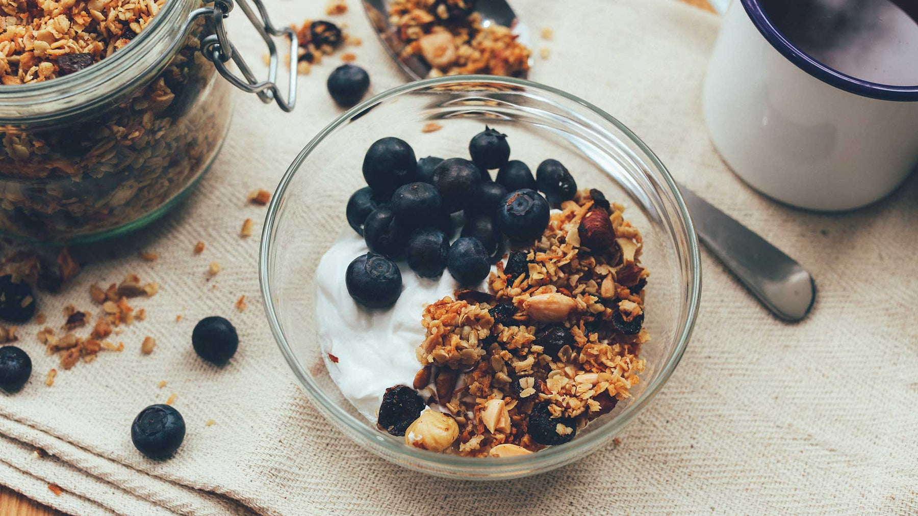 bowl of granola with yoghurt and blueberries