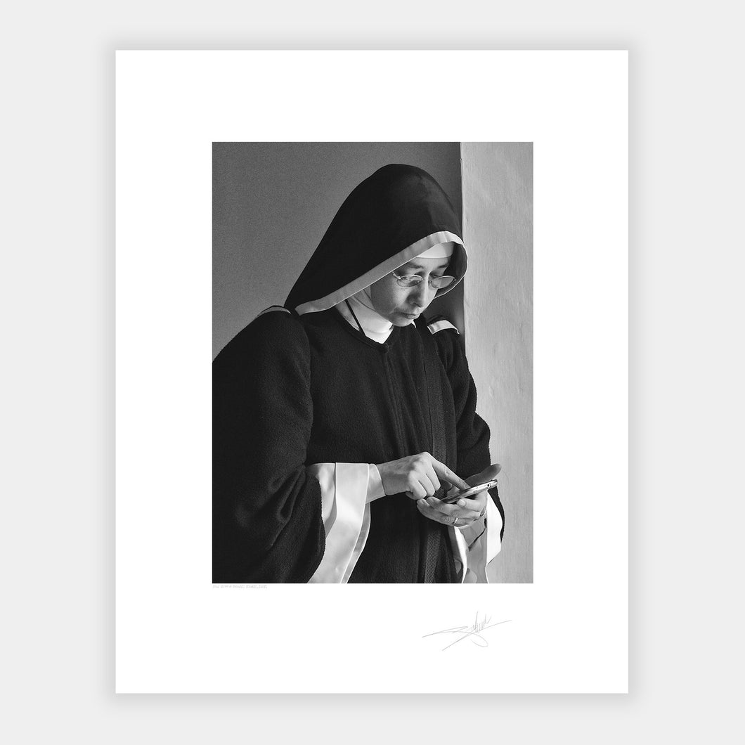 Nun with a phone