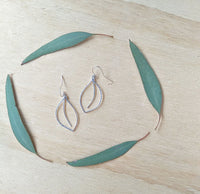 Falling Leaves Earrings. Hand formed sterling silver drop earrings