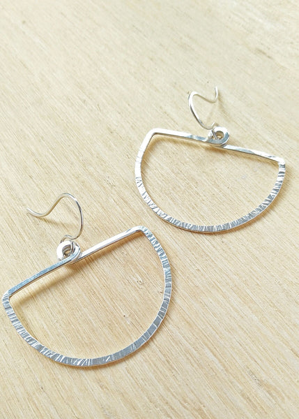 Della Earrings. Hand formed Sterling Silver drop earrings