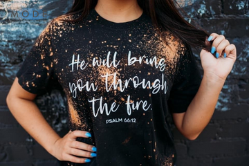 HE WILL BRING YOU THROUGH THE FIRE HAND BLEACHED GRAPHIC TEE IN BLACK