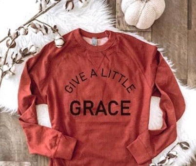 GIVE A LITTLE GRACE FRENCH TERRY CREWNECK PULLOVER IN RUST-Graphic Sweatshirt-MODE-Couture-Boutique-Womens-Clothing