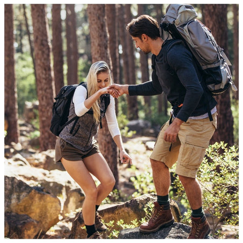 Couple going for a hiking using towel