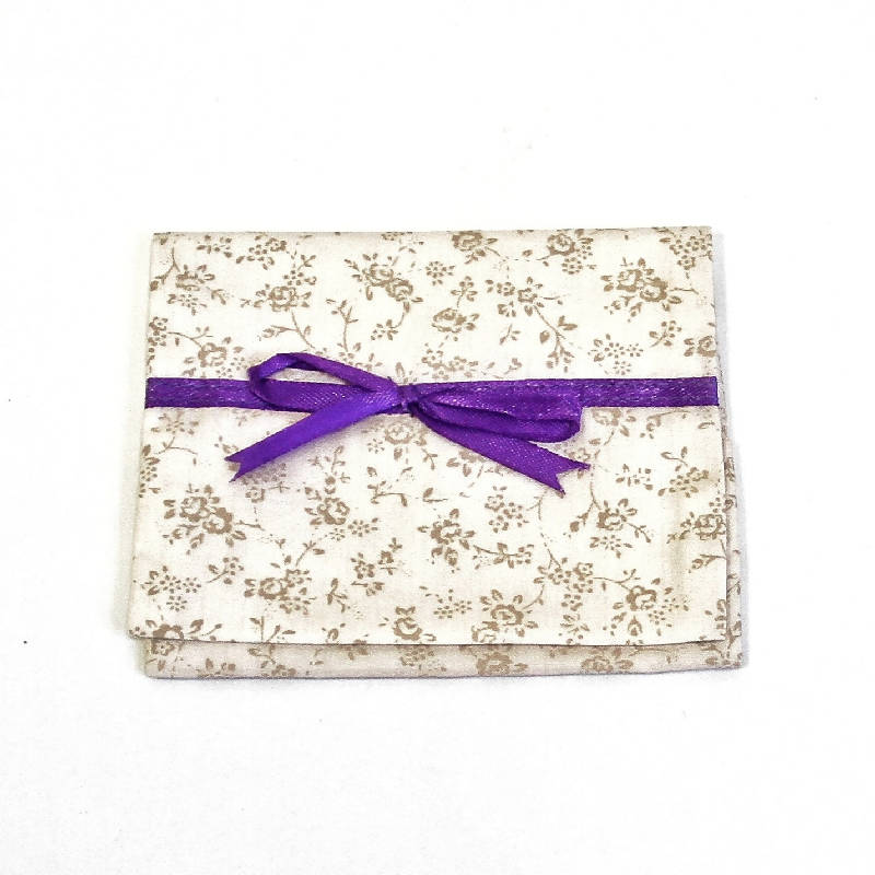 Tissue pouch with ribbon