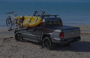 Dropracks elevating lowerable roof rack with bike carrier and kayak carrier