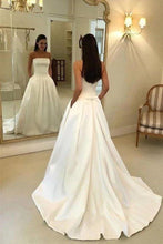 Load image into Gallery viewer, Charming A Line Satin Strapless Wedding Dresses with Pockets Long Bridal Dresses XHMPST15091
