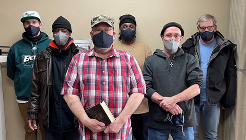 Group of men, wearing a masks from facecoverUS