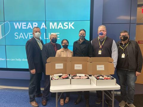 Image with school board members and donation masks
