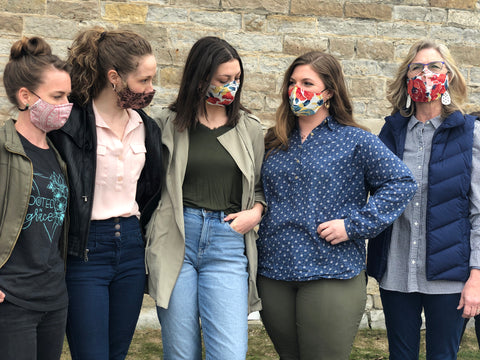 group of ladies with masks on