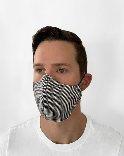 Man wearing Houndstooth Mask. Houndstooth pattern mask.