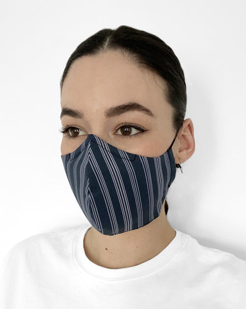 Woman in navy mask with white pinstripes.