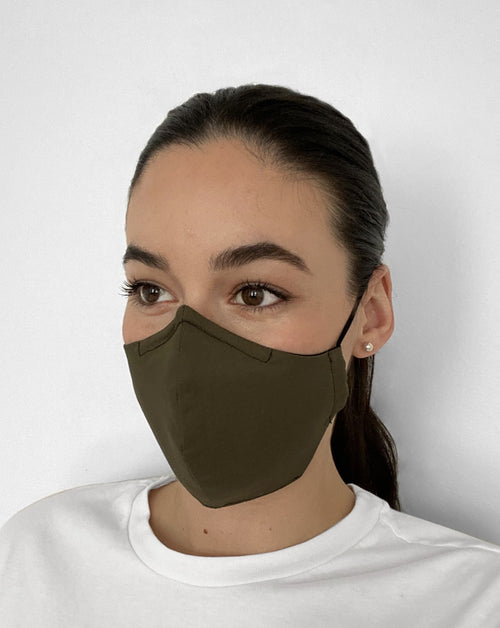 Women wearing Olive Green Mask. Olive green color mask.