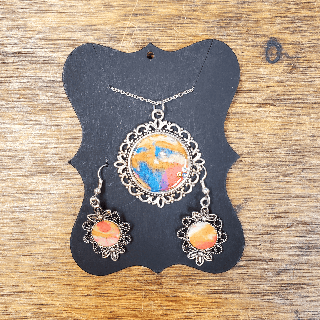 Under the Cherry Blossoms' acrylic pour jewelry