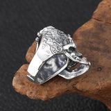 A ring with two dragons over a skull