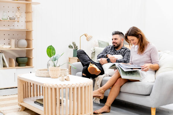 couple sitting by coffee table