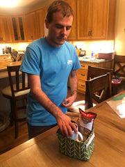 Basketeer Brett putting together a Just Because Gift Basket