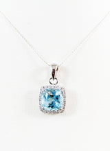 Load image into Gallery viewer, 14kt White Gold Diamond and Genuine Blue Topaz pendent