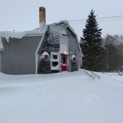 Ellison Bay Pottery barn covered with snow