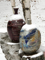 Two handthrown pottery vases outside in the snow