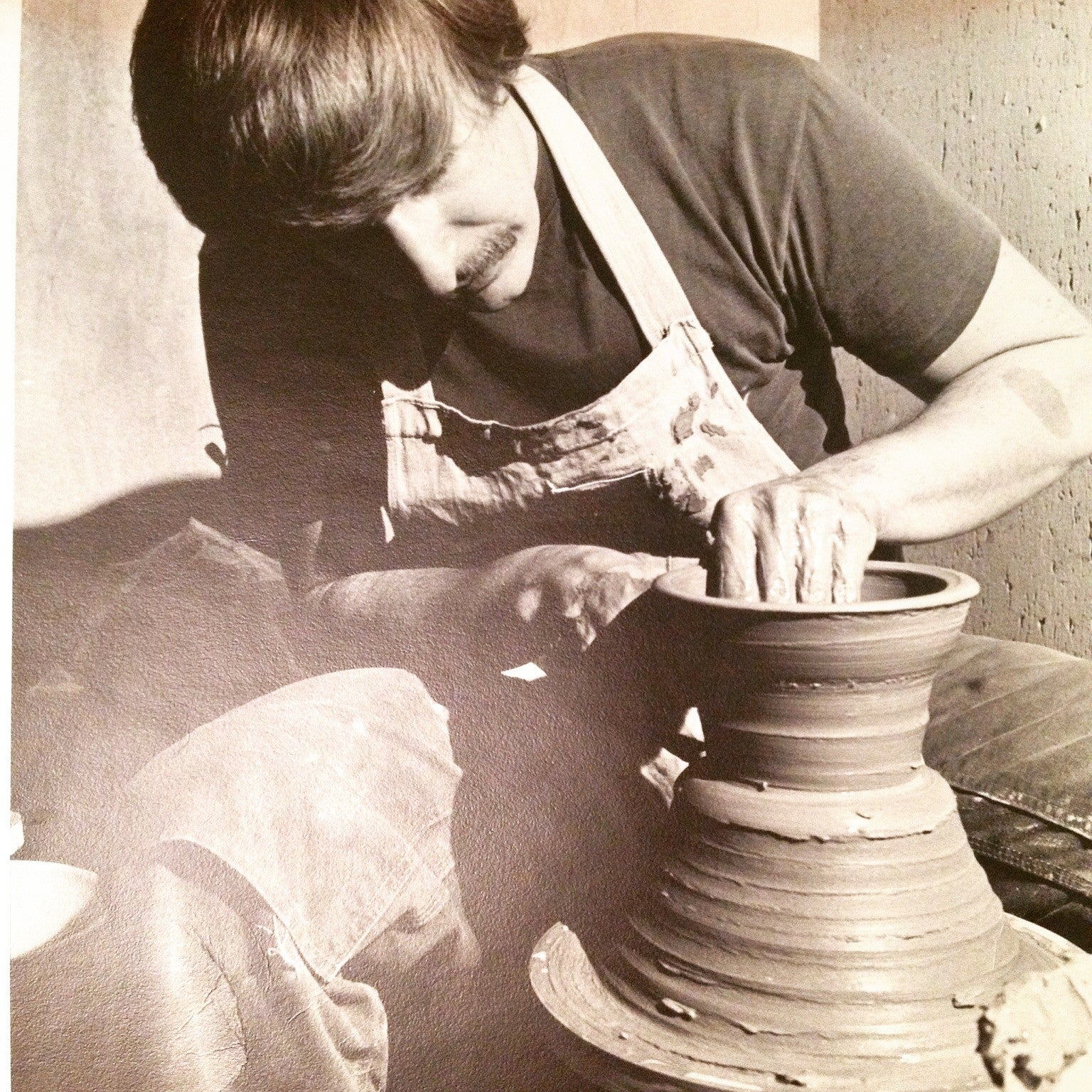 John Dietrich throwing on the potters wheel